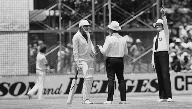Umpires talk to Dennis Lillee about his illegal aluminium bat during the first Test against England at Perth, December 1979 © Getty Images