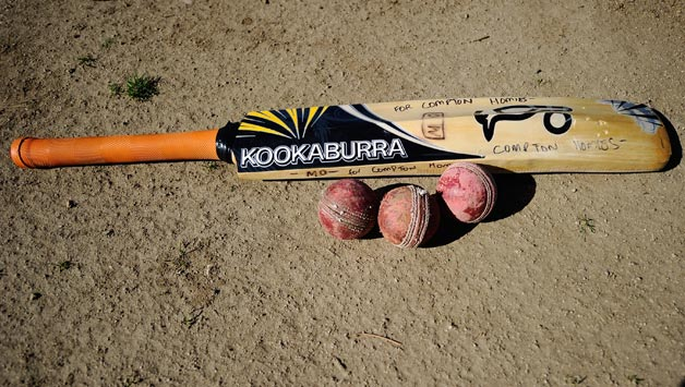 A-Compton-Homies-bat-and-balls-lie-on-the-cricket-grounds-during-a-training-session-wit