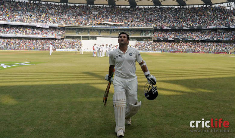 Sachin Tendulkar acknowledged the spectators as he walks off after being dismissed for 74.