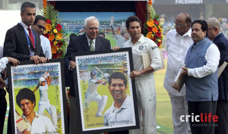 Kapil Sibal, former Telecom and Human Resource minister presents the commemorative stamp launched by the Government of India in honour of the Little Master © IANS
