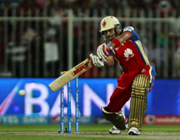 Royal Challengers Bangalore player Virat Kohli in action during the 11th match of IPL 2014 between Kolkata Knight Riders and Royal Challengers Bangalore, played at Sharjah Cricket Stadium in Sharjah of United Arab Emirates on April 24, 2014. (Photo: IANS)