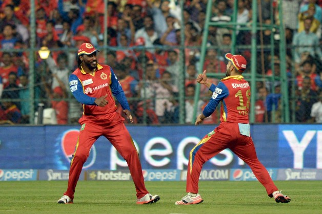 Chris Gayle (Left) and Virat Kohli (Right) will be key to RCB's success against MI © IANS