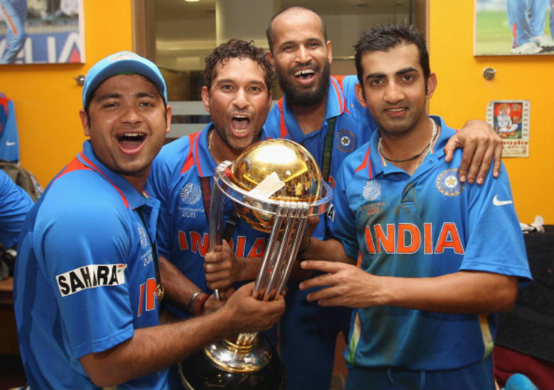 Indian cricketers (from left) Piyush Chawla, Sachin Tendulkar, Yusuf Pathan and Gautam Gambhir celebrate with the World Cup after winning it in 2011 (Courtesy: Getty Images)