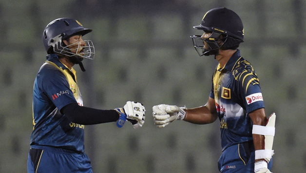 Tillakaratne Dilshan (left) and Dinesh Chandimal put on 110 runs for the opening wicket © AFP