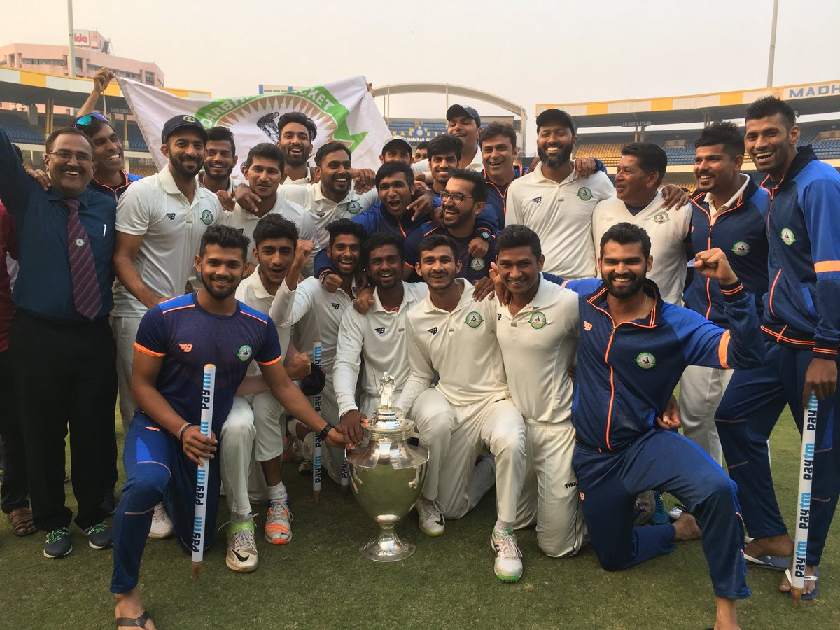 Vidarbha celebrate with the Ranji Trophy.