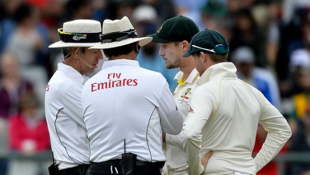 Cameron Bancroft (second from right) and Steven Smith © Getty Images