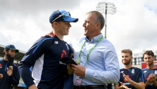 Ollie Pope being presented the cap by Alec Stewart as team-mates look on© Getty Images