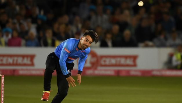 Rashid Khan bowling for Sussex in their T20 blast game against Gloucestershire at Hove © Getty Images