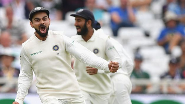 An elated Virat Kohli after taking a blinder at third slip to remove Ollie Pope