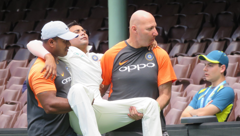 Prithvi Shaw had to be carried off the field after twisting his left ankle at the SCG.