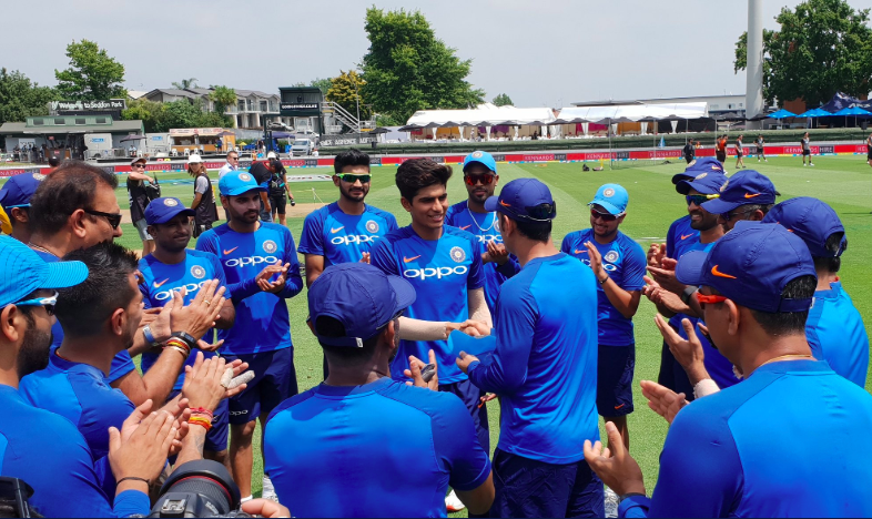 Shubman Gill, 19, receives his first ODI cap from MS Dhoni at Seddon Park.
