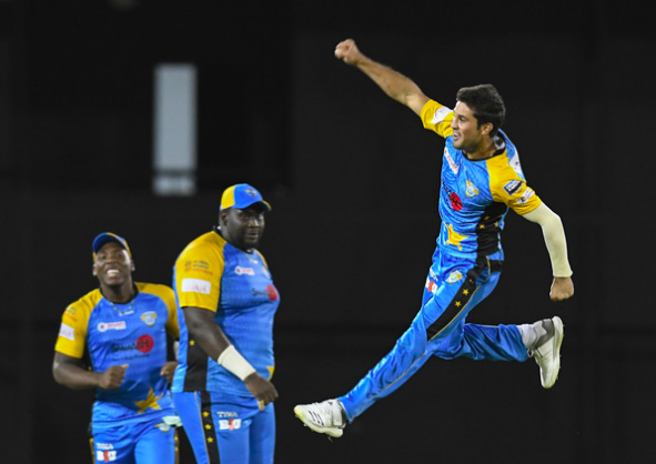 Qais Ahmad celebrates a wicket during the Caribbean Premier League.