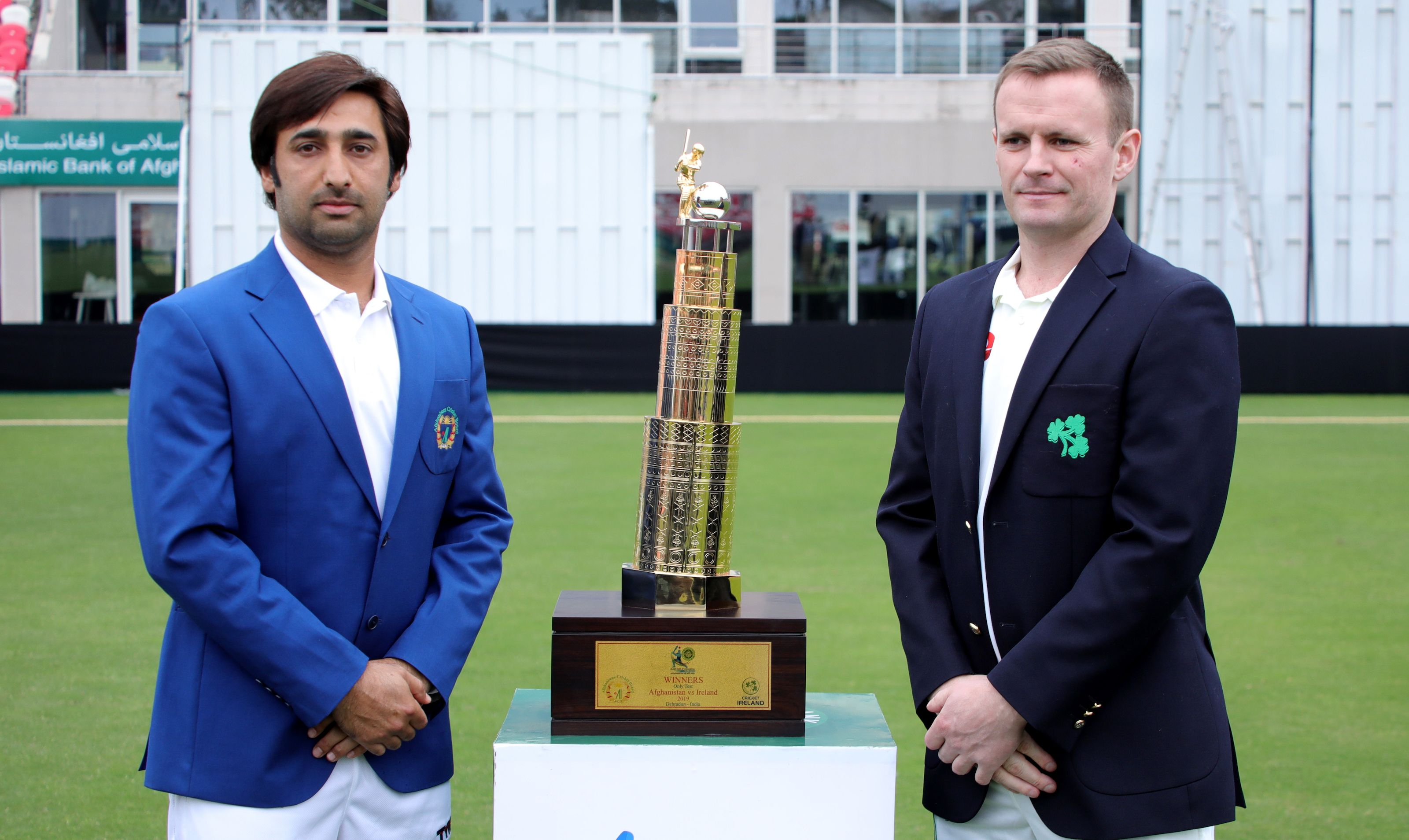 Asghar Afghan and William Porterfield pose with the series trophy.