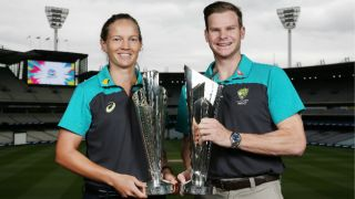 Steven Smith and Meg Lanning pose with ICC T20 World Cup 2020 trophies